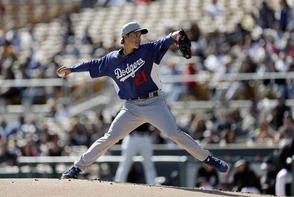 Zack Greinke pitches against the Chicago White Sox in the first inning of a Feb. 24 exhibition game.