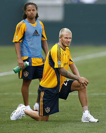 David Beckham and Galaxy teammate Cobi Jones take a break during practice Monday at the Home Depot Center.