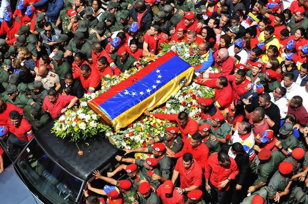 The casket of Venezuelan President Hugo Chavez is transported from the Military Hospital to the Military Academy.