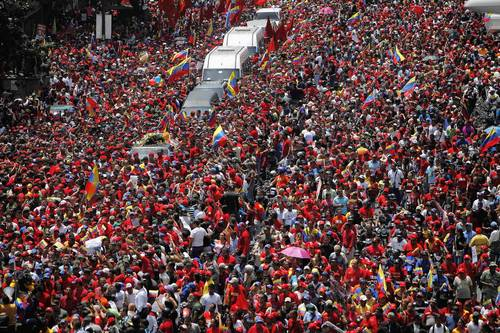 The coffin of Venezuela's late President Hugo Chavez is driven through the streets of Caracas after leaving the military hospital where he died of cancer.