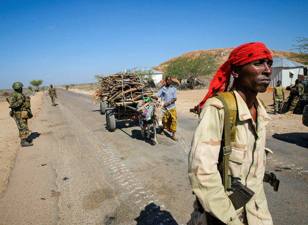 A photo taken and released by the African Union-United Nations Information Support team shows a Somali National Army soldier walking along a road in the town of Buur-Hakba in February.