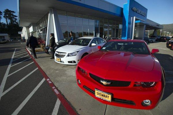 Cars are displayed at Stewart Chevrolet Cadillac in Colma, Calif. Increasing auto sales helped push economic growth in the western region, the Federal Reserve reported.