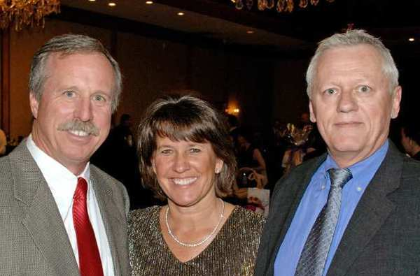 Burbank Top Award for Citizenship recipient, Ray Krakowski, left, and his wife, Tricia, welcomed to The Castaway for Friday's gala by BTAC board member Will Rogers.