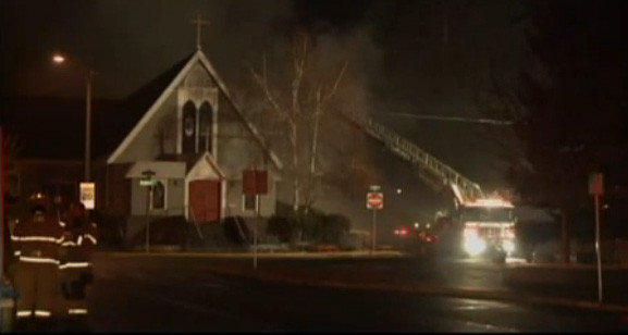 Firefighters battle a blaze at Trinity Episcopal Church, one of several suspicious fires that struck Bend, Ore., early Wednesday.