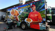 The whirs and hisses of drills and welding torches carry outside a warehouse tucked away in a Fort Lauderdale office park. Inside, rows of step vans and delivery trucks are being reborn as food trucks.