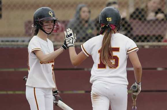 Ocean View's Olivia Russ, left, high fives Billi Derleth after she scored during a nonleague game against Tustin on Tuesday.