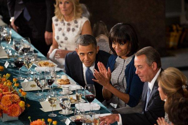 President Obama shares a moment with First Lady Michelle Obama and House Speaker John A. Boehner (R-Ohio) during the inaugural luncheon at the Capitol on Jan. 21.