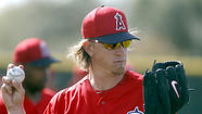 TEMPE, Ariz.—Jered Weaver looked strong during a three-inning stint, top prospect Kaleb Cowart hit a three-run double in the first inning, and the Angels broke a tie with seven runs in the eighth inning for a 12-6 exhibition victory over Team Italy at Tempe Diablo Stadium on Wednesday.