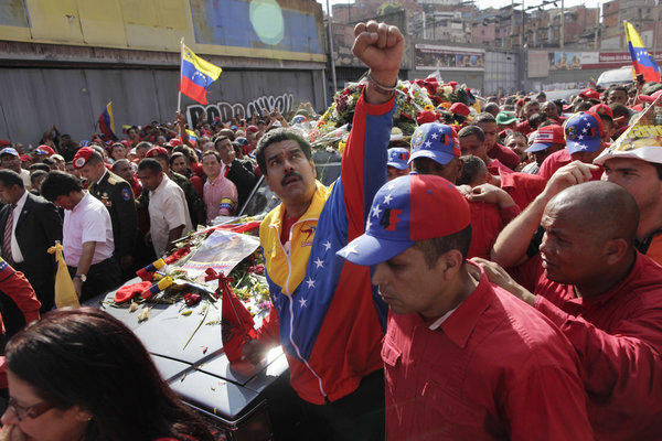 Venezuelan Vice President Nicolas Maduro looks to the heavens as he escorts the coffin carrying the body of late President Hugo Chavez through the streets of Caracas on Wednesday. Maduro is likely to benefit from Chavez's enduring influence on Venezuelan politics, as the late president made a deathbed endorsement of Maduro as best to succeed him.