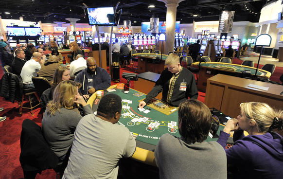 Customers play at the Black Jack tables at Hollywood Casino. Hollywood Casino is the first to offer table games in the state.