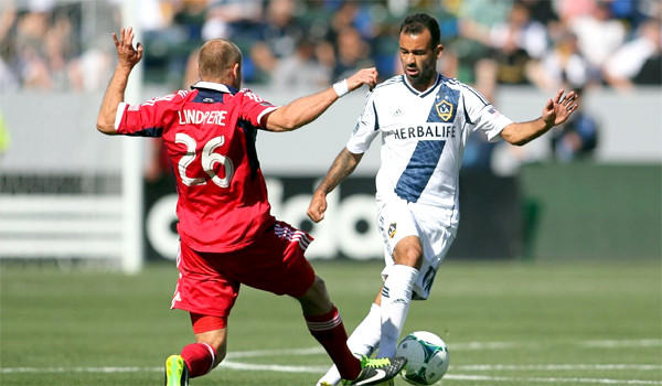 Joel Lindpere defends Juninho during the Galaxy's 4-0 victory over the Chicago Fire on March 3.