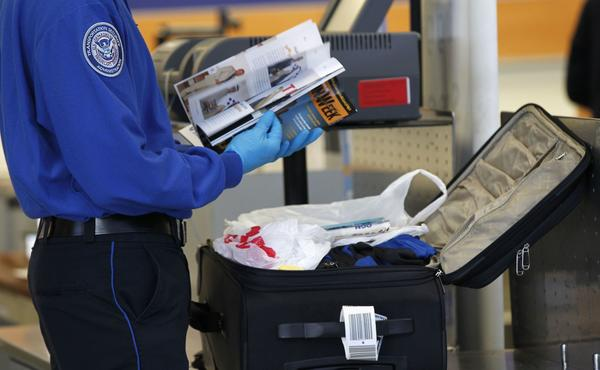 A TSA officer inspects the contents of a piece of luggage at Los Angeles International Airport on March 4.