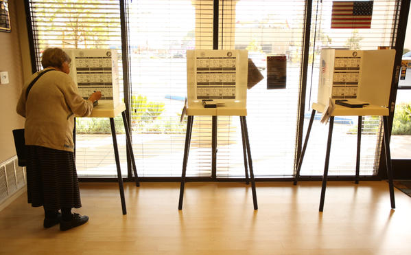 Olga Korn votes in the Los Angeles city election this week. Voters in two of California's senate districts cast ballots next week.