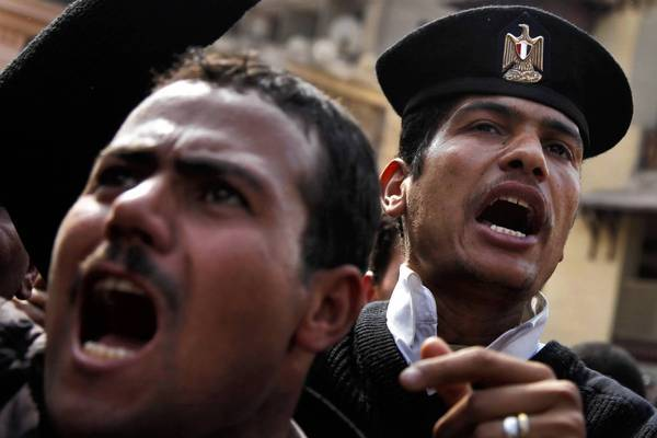 "Egyptian police officers demonstrate in front of the Interior Ministry. The revolution that toppled President Hosni Mubarak ""has changed the system. We're confused about who we are now,"" said one officer."