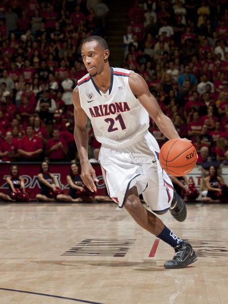 University of Arizona point guard Kyle Fogg drives toward the basket during the 2012 Pac-12 tournament.