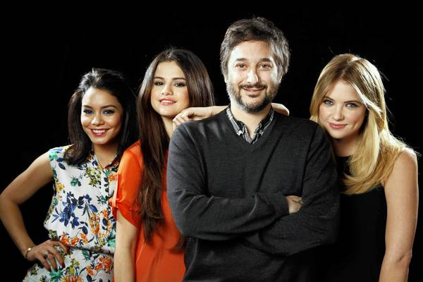 "Director Harmony Korine poses for a portrait with three of his four lead actresses from his new film ""Spring Breakers"" at the SLS hotel. From left, Vanessa Hudgens, Selena Gomez and Ashley Benson. The fourth actress, not shown, is Rachael Korine."
