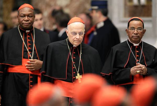 Cardinals Gabriel Zubeir Wako of Sudan, from left, Francis George and Telesphore Toppo of India arrive for a prayer session Wednesday at St. Peter's Basilica in the Vatican. A news conference with George was canceled Wednesday.
