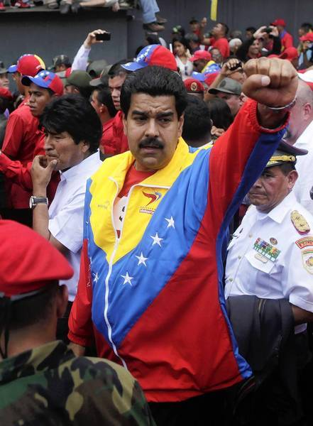 Venezuelan Vice President Nicolas Maduro takes part in the procession accompanying the coffin of Hugo Chavez in Caracas. At left is Bolivian President Evo Morales.