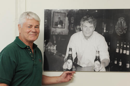 "A day at Yuengling Brewery.  Richard (Dick)  Yuengling, gives a personal tour around ""America's Oldest  brewery.""  In photo, he stands next to a photo taken 20 years ago in the brewery bar on Mahantongo Street in Pottsville. Photo taken on June 7th, 2011."