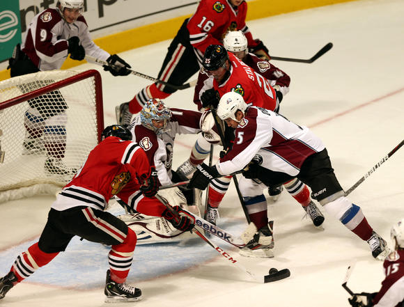 The Blackhawks' Daniel Carcillo, left, scores the winner. (Chris Sweda/Tribune photo)
