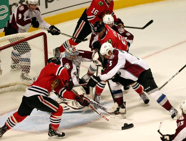 The Blackhawks' Daniel Carcillo, left, scores the winner. (Chris Sweda/Tribune photo)