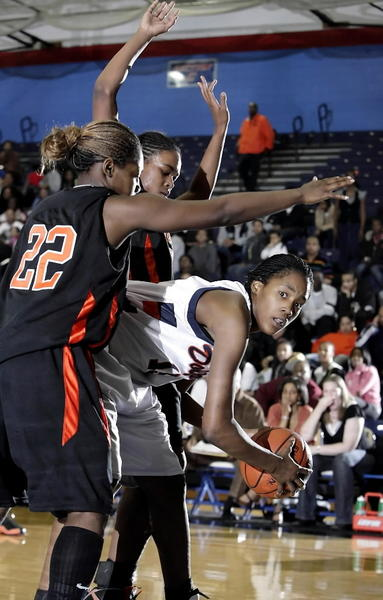 Young's Mariah King looks to pass out of a double team from Bogan's Marissa Johnson (22, left) and Brittany Cochran in the second half. Young defeated Bogan 56-38 to win the City Championshipat the DePaul Athletic Center in Chicago, IL on February 7, 2009.