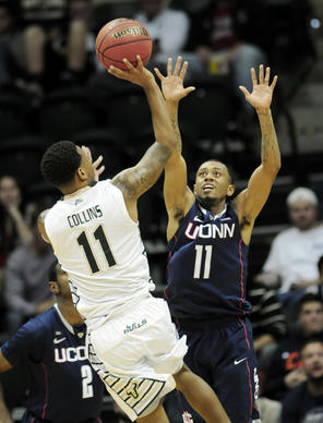 Ryan Boatright on defense against USF's Anthony Collins late in the second half. The UConn men met the University of South Florida in Tampa for their second to last game of the season Wednesday night. UConn lost, 65-51.