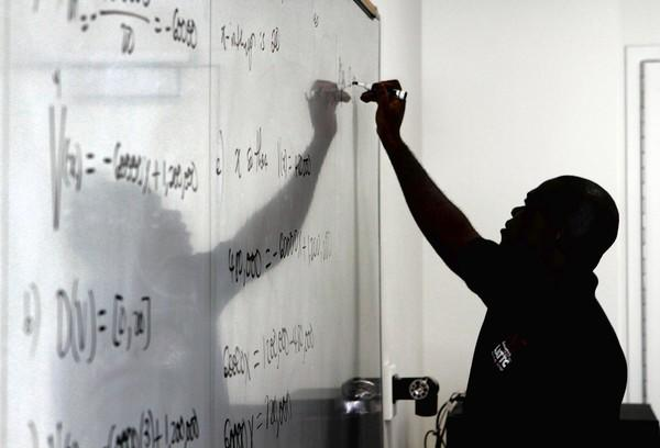 Simpson Rodgers teaches intermediate algebra to students at Los Angeles Trade Tech College. The overburdened community college system is the entry point for thousands of college students each year.