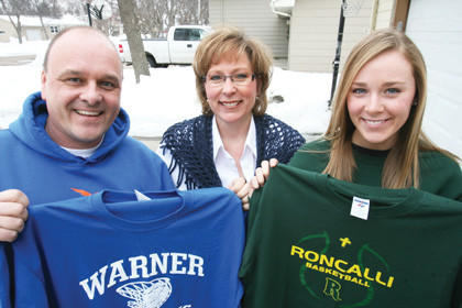 Stew Bohle, left, and daughter Emily, right, will participate in state girls¿ basketball tournaments this weekend. Stew is the head coach of Warner, and Emily is a junior on the Aberdeen Roncalli team. Wife and mother, Lori, finds herself in the middle supporting both teams. She will travel back and forth between Huron and Watertown if scheduling permits to watch both squads.