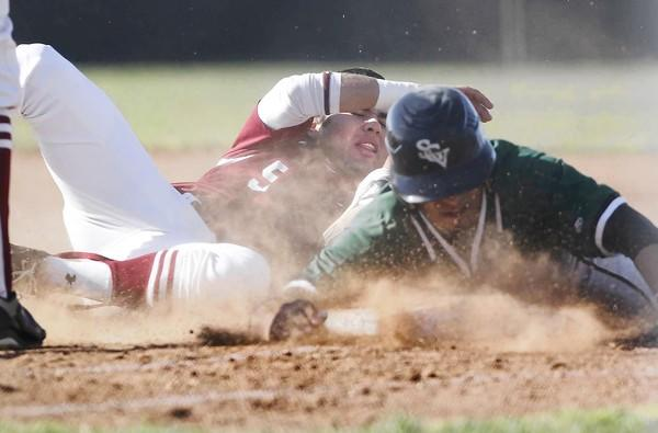 Estancia High's Tyler Rios, left, tags out Nogales' Erik Gonzales during the third inning in a Costa Mesa Division semifinal of the Newport Elks Tournament on Wednesday.