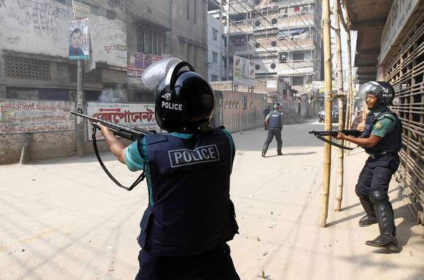 Police fire rubber bullets after activists of Bangladesh Nationalist Party (BNP) threw hand bombs at them during a country wide strike in Dhaka. Bangladesh Nationalist Party and it's alliance called the daylong strike in protest against what it said were violence and killings by the police in their protest rally over war tribunals on Wednesday, local media reported.