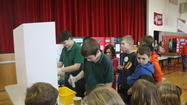(March 7, 2013) PROSPECT HEIGHTS, IL – From calculating the best angle for shooting a basket to using fruit for batteries to turning water into ink, Saint Alphonsus Liguori middle school students put forth their best effort for the school's 2013 science fair.