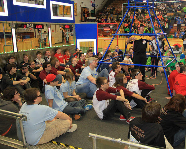 The Charlevoix robotics team listens at the outset of a competition Saturday in Traverse City.