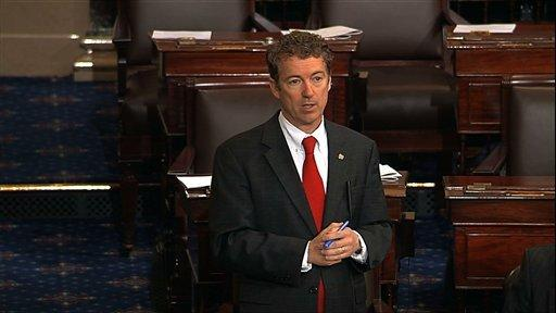 This video frame grab provided by Senate Television shows Sen. Rand Paul, R-Ky. speaking on the floor of the U.S. Senate on Wednesday night in a filibuster seeking to blocking confirmation of President Barack Obama's nominee John Brennan to lead the Central Intelligence Agency.