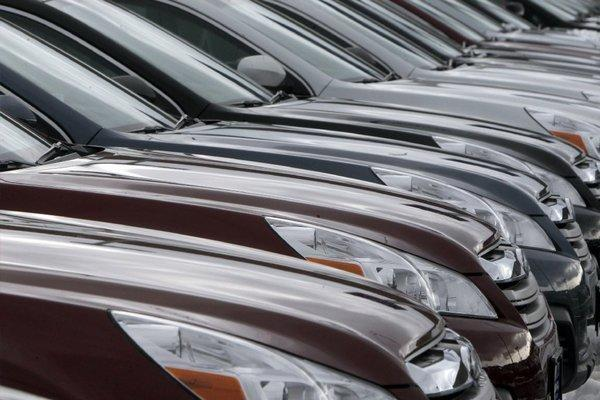 Subaru Legacys are lined up at a dealership in Berlin, Vt. Subaru is recalling some Legacy cars and other models because of a problem that may cause a vehicle's engine to start on its own.