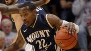 Rashad Whack scored 17 of his team-high 19 points in the second half to lead fifth-seeded Mount St. Mary's to a 75-69 win at fourth-seeded host Bryant in the Northeast Conference tournament quarterfinals Wednesday night.