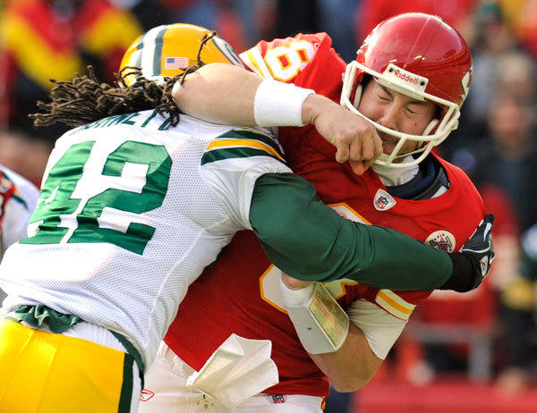 Kansas City Chiefs quarterback Kyle Orton reacts to being hit by Green Bay Packers free safety Morgan Burnett after getting off a pass during the first half of their AFC-NFC NFL football game at Arrowhead Stadium in Kansas City, Missouri December 18, 2011.