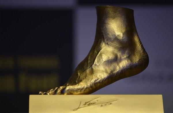 A pure gold replica of Lionel Messi's left foot, priced at $5.25 million, is unveiled in Tokyo.
