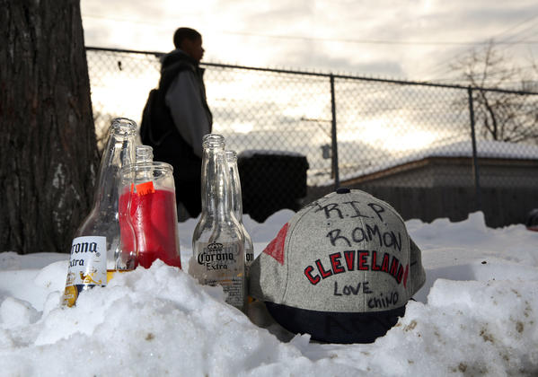 A memorial for Ramon Colon sits in the snow on North St. Louis Avenue.