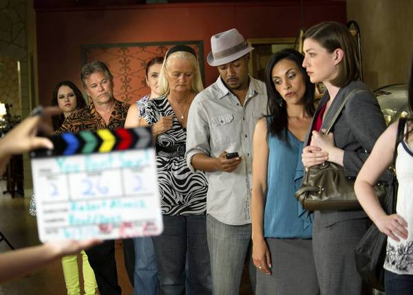 "A scene from ""You Don't Say!"" that was filmed at the Blissful Banana Cafe in Orland Park and features mostly extras. Chicago actress Julia Chereson, far right in gray, plays the lead character."