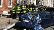Baltimore firefighters free victim from burning car