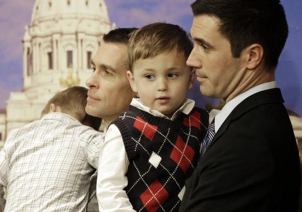 Dr. Paul Melchert, left, and his partner, James Zimerman, in St. Paul, Minn., where a bill to legalize gay marriage has been introduced.