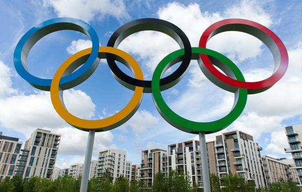 The London 2012 Olympic Athletes Village is pictured through the Olympic Rings in east London, on July 12, 2012.