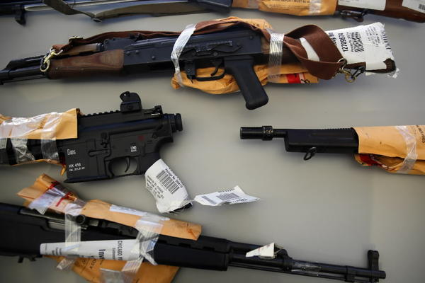 An assortment of weapons representing the types seized by members of the Chicago Police Department in the first two weeks of the new year sit on display prior to a press conference to discuss the city's growing number of illegal firearms at the Gresham (6th) District in Chicago.