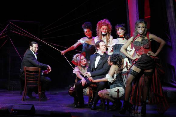 "Constantine Maroulis as Henry Jekyll, Laird Mackintosh as John Utterson, Deborah Cox as Lucy and ensemble in ""Jekyll & Hyde."""