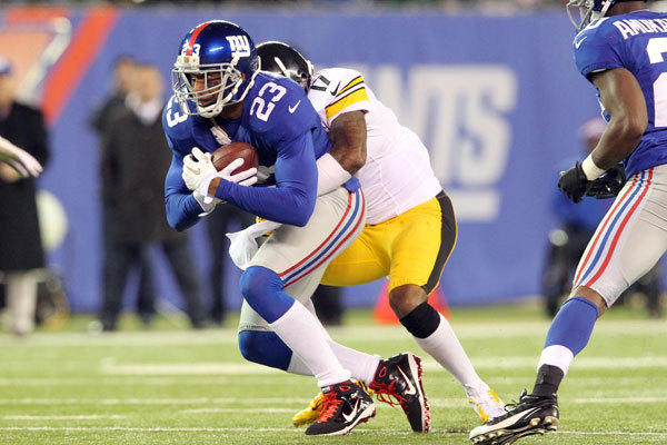 New York Giants corner back Corey Webster (23) intercepts a pass intended for Pittsburgh Steelers wide receiver Mike Wallace (17) during the third quarter of an NFL game at MetLife Stadium.