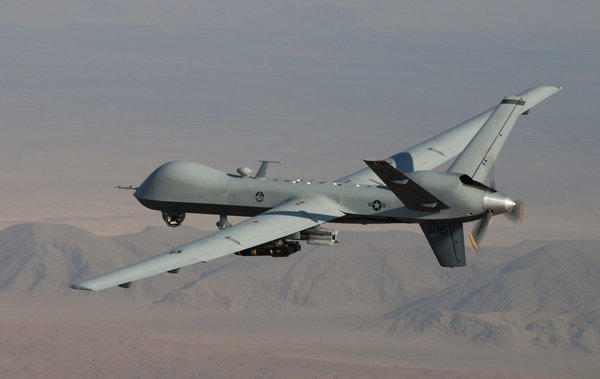 An MQ-9 Reaper, armed with laser-guided munitions and Hellfire missiles, during a combat mission over southern Afghanistan.