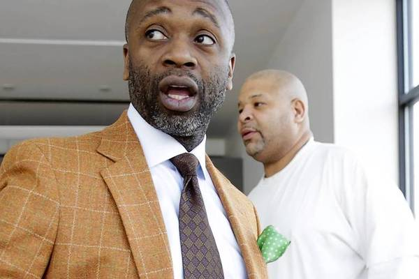Artist Theaster Gates, left, talks with maintenance worker Harold Brown as they prepare the new University of Chicago-sponsored Arts Incubator.
