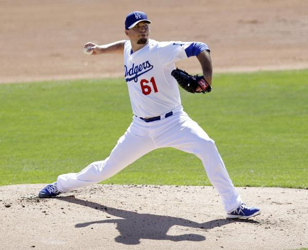 Josh Beckett, shown here earlier in the exhibition season, pitched four strong innings on Thursday.