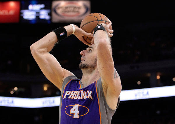Phoenix Suns center Marcin Gortat (4) shoots the ball against the Golden State Warriors during the first quarter at Oracle Arena.